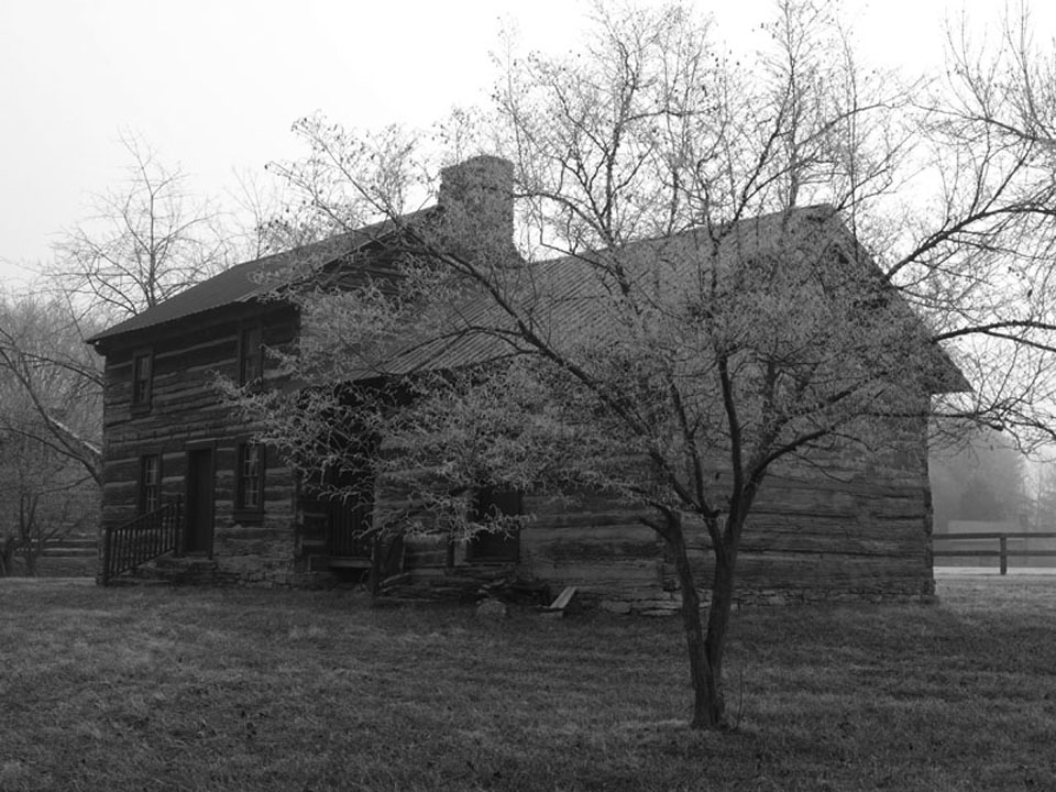 Black and white of the back of Hawkins Cabin at the Pioneer Village